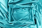 Background of blue fabric and rectangle.
