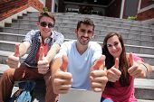 Happy Students Showing Thumb Up