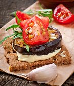 Vegetarian Diet Crispbread sandwiches with garlic cream cheese, roasted eggplant, arugula and cherry