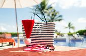 beach, summer, christmas, holidays and vacation concept - close up of santa helper hat, flip-flops,