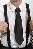 Close-up Of Businessman With Suspenders And Tie