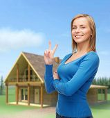 gesture and people concept - smiling teenage girl showing v-sign with hand