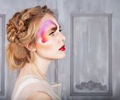 Woman With Perfect Butterfly Make Up And Hairstyle