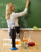 stock photo of formulas  - Chemistry laboratory glassware with liquid formula at the classroom - JPG