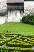 GRUYERES, SWITZERLAND - JULY 8, 2014: Garden and balcony at Gruyeres Castle. Located in the medieval