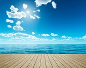 An illustration of a bright sky background with a wooden jetty foreground