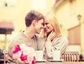 summer holidays, love, travel, tourism, relationship and dating concept - romantic happy couple kiss