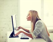 picture of happy woman kissing computer monitor