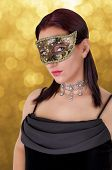Beautiful woman in carnival mask.