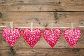 Red Hearts Hanging On The Clothesline