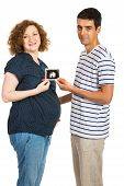 Pregnant Couple Showing Ultrasound Photo