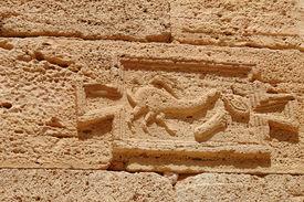 foto of pene  - Indication Roman road in the archaeological site of Leptis Magna Libya - JPG