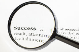 foto of pronunciation  - The word success seen through a magnifying glass - JPG