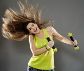 foto of cardio exercise  - Fitness young woman doing cardio aerobic exercises with light dumbbells - JPG