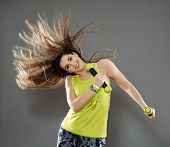picture of cardio exercise  - Fitness young woman doing cardio aerobic exercises with light dumbbells - JPG
