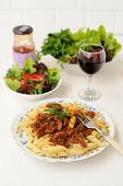 Pasta With Meat Sause, Green Salad And Wine