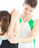 Young Physical Therapist Checking A Woman's Shoulder