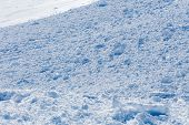 stock photo of avalanche  - Close up of snow clods on the track of the avalanche in the mountains - JPG