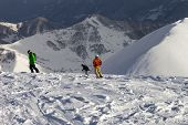 Freeriders On Off-piste Slope In Sun Evening