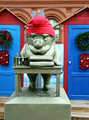 image of gnome  - Gnome in a red cap photographed close - JPG