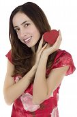 Smiling Attractive Woman With A Red Heart