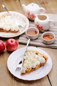 Piece Of Cake Decorated With Whipped Cream With Teaware And Apples T