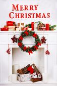 Fireplace with Christmas decoration on white wall background