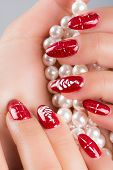 stock photo of nail paint  - nails painted with the colors of Christmas - JPG