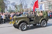 Pretty woman - major of army drives car on parade