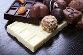 foto of bitters  - Bars of white and bitter chocolates with candies - JPG