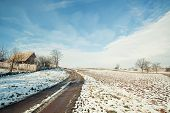 Rural road and house in snow