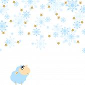 Funny sheep - the symbol of the year 2015 - looking at snowfall with enjoyment and smile