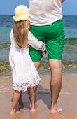Young father and adorable little daughter outdoors on the beach