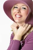 Happy smiling woman in large brimmed sunhat