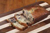 pic of fresh slice bread  - Freshly baked and sliced banana bread with blueberries added - JPG