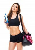 Portrait Of Attractive Caucasian Smiling Woman With Bottle Of Water And Sports Bag