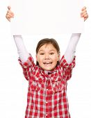 Little girl is holding a blank banner, isolated over white