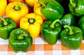 Close Up Of Green And Yellow Bell Pepper Or Sweet Pepper Or Capsicum  On The Table