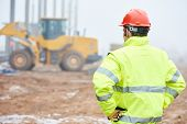 image of engineering construction  - construction foreman worker is watching building works on site - JPG