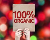100% Organic card with colorful background with defocused lights