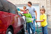 picture of car wash  - Smiling happy family washing the family car - JPG