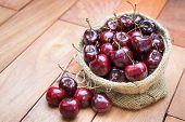 Fresh Red Cherries On Wooden