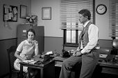 1950S Businessman And Secretary Working In The Office