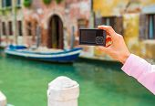 Closeup On Young Woman Taking Photo In Venice, Italy