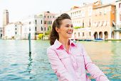 Portrait Of Happy Young Woman On Grand Canal In Venice, Italy