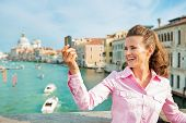 pic of piccolo  - Happy young woman standing on bridge with grand canal view in venice italy and taking self photo - JPG