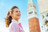 Portrait Of Happy Young Woman Against Campanile Di San Marco In