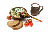 Russian Dumplings In A Clay Bowl, Bread, Milk And Tomatoes On A White Background