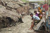 Woman takes care of her kids, Mongla, Bangladesh.