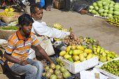 Men sell fruits at the local market in Bandarban, Bangladesh.